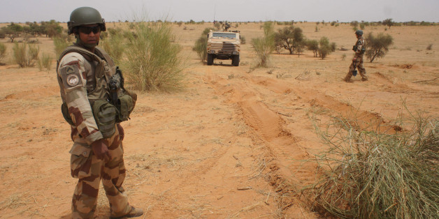 A French soldier stands next to an armored vehicle in Inat, Mali, May 27, 2016.  REUTERS/Media Coulibaly