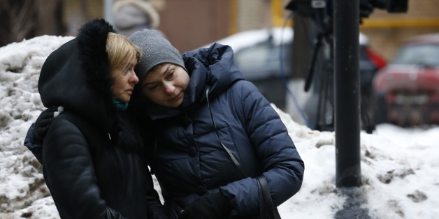 MOSCOW, RUSSIA - DECEMBER 25, 2016: Two women seen outside the Alexandrov Hall, a rehearsal room of the Alexandrov Ensemble, where Moscow residents bring flowers in memory of the victims of a Russian Defense Ministry plane crash. A Tupolev Tu-154 plane of the Russian Defense Ministry with 92 people on board crashed into the Black Sea near the city of Sochi on December 25, 2016. The plane was carrying members of the Alexandrov Ensemble, Russian servicemen and journalists to Russia's Hmeymim air b
