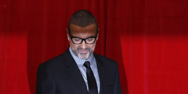 British singer George Michael poses for photographers before a news conference at the Royal Opera House in central London May 11, 2011.   REUTERS/Stefan Wermuth (BRITAIN - Tags: ENTERTAINMENT)