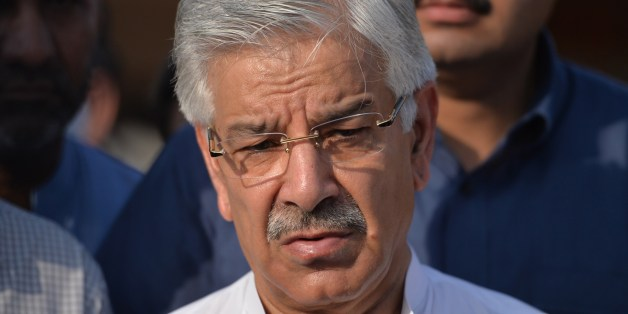 Pakistani Defence Minister Khawaja Asif speaks with media after meeting with patients, who were injured during cross-border shelling, at a military hospital in the eastern city of Sialkot on August 29, 2015. Pakistan will respond 'with full force' if India continues to target the civilian population, Islamabad's defence minister said, after 13 people died when rivals traded fire across their disputed border. Nine died near the city of Sialkot in Pakistan's Punjab province, and more than 40 were