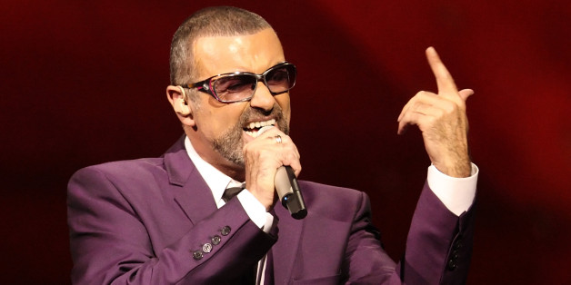 """British singer George Michael performs on stage during his """"Symphonica"""" tour concert in Vienna September 4, 2012. George Michael hailed the Vienna medical team that brought him back from the brink of death last year as he prepared to resume his tour interrupted for months by a severe lung infection. The former Wham! frontman, who went on to pursue a successful solo career, fell ill in the Austrian capital in November and was diagnosed with severe pneumonia. He spent a month in Vienna's General H"""