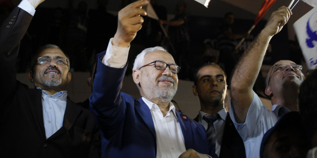"Rached Ghannouchi, leader of the Islamist party Ennahda, waves the party flag outside Ennahda's headquarters in Tunis  October 27, 2014.Tunisia's Ennahda party, the first Islamist movement to secure power after the 2011 ""Arab Spring"" revolts, conceded defeat on Monday in elections that are set to make its main secular rival the strongest force in parliament. Official results from Sunday's elections - the second parliamentary vote since Tunisians set off uprisings across much of the Arab World by overthrowing autocrat Zine El-Abidine Ben Ali - were still to be announced. REUTERS/Zoubeir Souissi (TUNISIA - Tags: ELECTIONS POLITICS)"