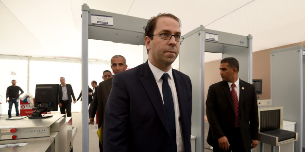 Tunisian Prime Minister Youssef Chahed (C) arrives to inspect the final preparation at the Congress Palace in the capital Tunis, on November 27, 2016, two days ahead of the opening ceremony of the 'Tunisia 2020' conference. Tunisia will host 2,000 business and finance executives from 40 countries this week in hopes of drumming up investment to boost its struggling economy. / AFP / FETHI BELAID        (Photo credit should read FETHI BELAID/AFP/Getty Images)