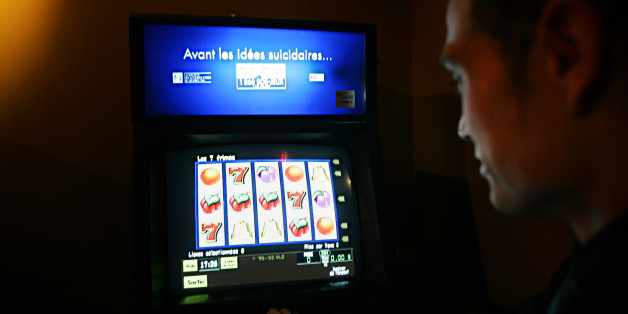 A man looks at a video lottery terminal with the slogan 'Before you have suicidal thoughts.' in Montreal, November 3, 2004 . Story by Miro. (Christinne Muschi/ Toronto Star). (Photo by Christinne Muschi/Toronto Star via Getty Images)