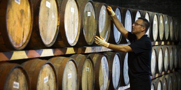 Danny Borzacciello stores a barrel at the Auchentoshan Distillery, a Single Malt whisky distillery, on the outskirts of Glasgow on December 12, 2016.  While most of Scotland voted against leaving the European Union, whisky makers have quietly been raising a wee dram to a side-effect of the Brexit vote -- a plunge in the value of the pound. The currency devaluation has made exports cheaper, generating a bump since 90 percent of Scotch whisky is sold outside Britain, although the industry warns the longer-term outlook is far more cloudy.   / AFP / ANDY BUCHANAN / TO GO WITH AFP STORY BY MARK MCLAUGHLIN        (Photo credit should read ANDY BUCHANAN/AFP/Getty Images)
