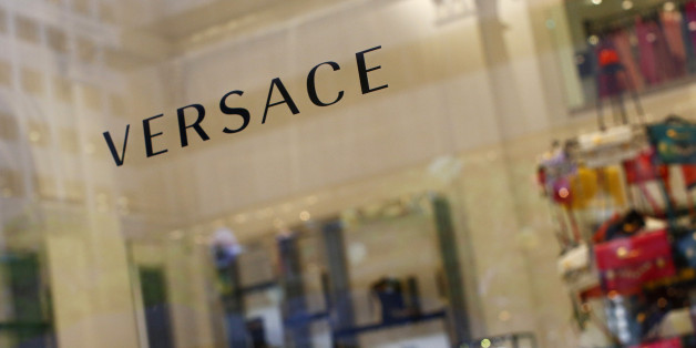 A sign is seen for high-end retail store Versace along 5th Avenue in New York May 19, 2013. Luxury spending in the United States collapsed after the 2008 financial crisis but roared back to pre-crisis levels by 2012. Sales in the Americas is expected to rise 5-7 percent this year, compared to 6-8 percent in mainland China and 0-2 percent in Europe, according to consultancy Bain & Co. Picture taken May 19, 2013. To match Insight LUXURY-US/  REUTERS/Eric Thayer (UNITED STATES - Tags: BUSINESS LOGO SOCIETY WEALTH)