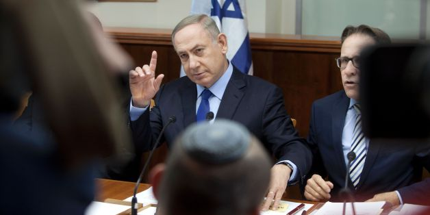 Israeli Prime Minister Benjamin Netanyahu chairs the weekly cabinet meeting in Jerusalem on December 25, 2016.Israel was defiant over a UN vote demanding it halt settlements in Palestinian territory, after lashing out at US President Barack Obama over the 'shameful' resolution. / AFP / AP AND POOL / Dan Balilty        (Photo credit should read DAN BALILTY/AFP/Getty Images)