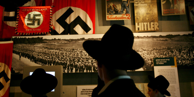 Ultra-Orthodox Jewish men visit the Yad Vashem Holocaust Museum in Jerusalem April 24, 2006. Israel marks the annual memorial day commemorating the six million Jews killed in the Holocaust of World War II on Monday.  REUTERS/Gil Cohen Magen