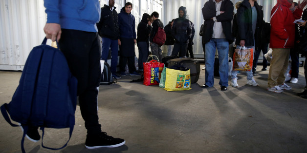 Migrants wait for a bus to leave the reception center for migrants and refugees near porte de La Chapelle in the north of Paris, France, November 25, 2016. The brand new 400-bed reception centre welcomes migrants giving them temporary refuge until French authorities find them a more permanent solution. Picture taken November 25, 2016.  REUTERS/Jacky Naegelen