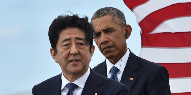 US President Barack Obama (R) listens as Japanese Prime Minister Shinzo Abe speaks at the USS Arizona Memorial on December 27, 2016 at Pearl Harbor in Honolulu, Hawaii.Abe and Obama made a joint pilgrimage to the site of the Pearl Harbor attack on Tuesday to celebrate 'the power of reconciliation. 'The Japanese attack on an unsuspecting US fleet moored at Pearl Harbor turned the Pacific into a cauldron of conflict -- more than 2,400 were killed and a reluctant America was drawn into World War II
