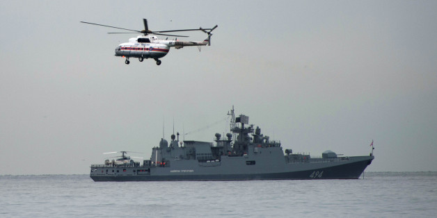 SOCHI, Dec. 27, 2016-- Photo taken on Dec. 27, 2016 shows a navy ship and a helicopter taking part in a rescue operation on the Black Sea coast at the crash site of Russian Defense Ministry's Tu-154 aircraft near Sochi, Russia. The main flight recorder of the Russian military Tu-154 aircraft that crashed Sunday into the Black Sea has been retrieved from the wreckage, the Russian Defense Ministry said Tuesday. (Xinhua/Sputnik via Getty Images)