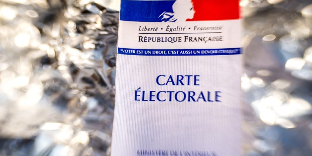 A picture taken on December 28, 2016 shows a French electoral card in Goewaersvelde during the electoral roll's registrations ahead of the French 2017 presidential election. / AFP / PHILIPPE HUGUEN        (Photo credit should read PHILIPPE HUGUEN/AFP/Getty Images)