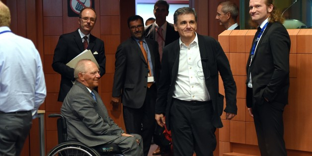 German Finance Minister Wolfgang Schauble (CL) and Greece's Finance Minister Euclid Tsakalotos (CR) attend an extraordinary Eurogroup meeting on Greece at the European Council in Brussels, on August 14, 2015. Eurozone finance ministers are scheduled to meet to go over a new bailout programme in return for reforms by Greece, but some of the creditors feel Athens' pledges are not precise enough. AFP PHOTO/Emmanuel Dunand        (Photo credit should read EMMANUEL DUNAND/AFP/Getty Images)
