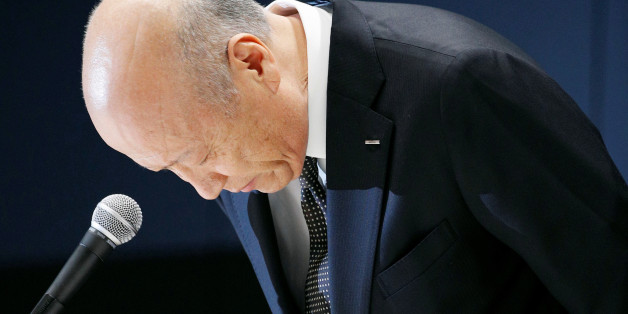 Tadashi Ishii, president of Japan's top advertising agency Dentsu Inc, bows during a news conference in Tokyo, Japan, in this photo taken by Kyodo December 28, 2016. Picture taken December 28, 2016. Mandatory credit Kyodo/via REUTERS ATTENTION EDITORS - THIS IMAGE WAS PROVIDED BY A THIRD PARTY. EDITORIAL USE ONLY. MANDATORY CREDIT. JAPAN OUT. NO COMMERCIAL OR EDITORIAL SALES IN JAPAN.     TPX IMAGES OF THE DAY