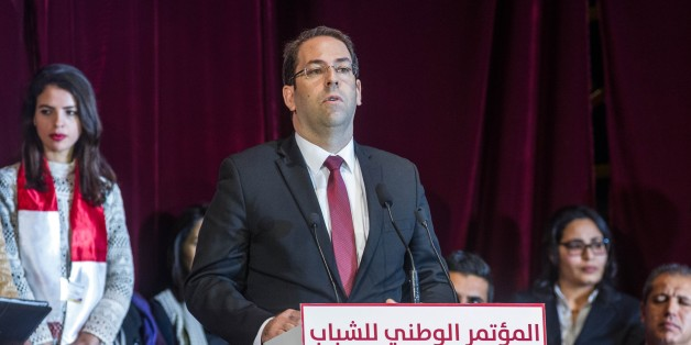 TUNIS, TUNISIA - DECEMBER 28: Tunisian Prime Minister Youssef Chahed gives a speech during the National Youht Congress at Conference Palace in Tunis, Tunisia on December 28, 2016.  (Photo by Amine Landoulsi/Anadolu Agency/Getty Images)