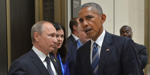 Russian President Vladimir Putin (L) meets with U.S. President Barack Obama on the sidelines of the G20 Summit in Hangzhou, China, September 5, 2016. Sputnik/Kremlin/Alexei Druzhinin/via REUTERS ATTENTION EDITORS - THIS IMAGE WAS PROVIDED BY A THIRD PARTY. EDITORIAL USE ONLY.
