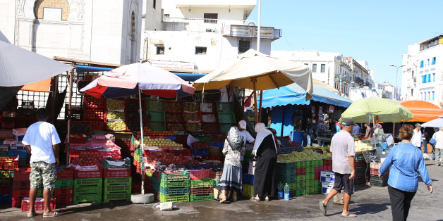 Women buy vegetables on a street market at  square  Sidi El Bechir in the old city in Tunis, Tunisia, August 9, 2016. Picture taken August 9, 2016. REUTERS/Zoubeir Souissi