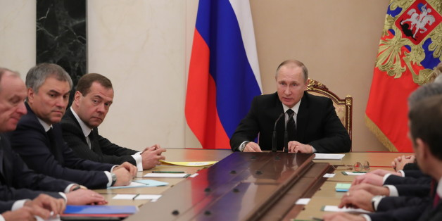 MOSCOW, RUSSIA - DECEMBER 28, 2016: Russia's President Vladimir Putin (C) chairs a meeting of the Russian Security Council at the Moscow Kremlin. Mikhail Klimentyev/Russian Presidential Press and Information Office/TASS (Photo by Mikhail Klimentyev\TASS via Getty Images)