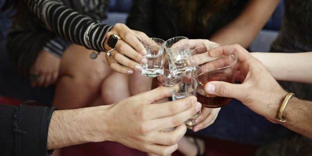 Group of friends toasting drinking together