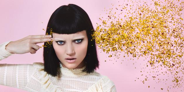 woman shooting glitter through head
