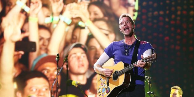 SYDNEY, AUSTRALIA - DECEMBER 13:  Chris Martin of Coldplay performs at Allianz Stadium on December 13, 2016 in Sydney, Australia.  (Photo by Mark Metcalfe/WireImage)
