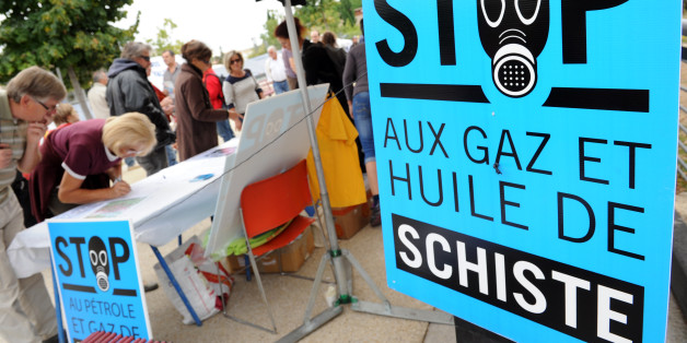 People sign a petition against the exploitation of shale gas and oil during a rally on September 22, 2012 in Saint-Christol-les-Ales, southern France. France's president revoked seven licenses to exploit shale gaz on September 14, arguing that 'no one can say that the exploitation of gas and oil shale by hydraulic fracturing, known only technique today is free of heavy risks to health and the environment'.  AFP PHOTO   SYLVAIN THOMAS        (Photo credit should read SYLVAIN THOMAS/AFP/GettyImages)