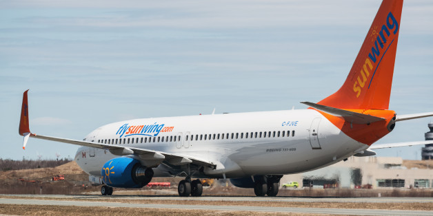Goffs, Canada - May 3, 2015: A Sunwing Airlines flight taxis towards the gate at Halifax Stanfield International Airport.