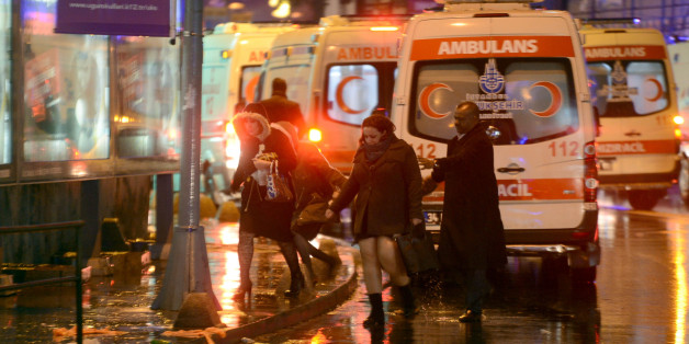 People flee as ambulances are on the attack site on January 1, 2017 in Istanbul.  At least two people were killed in an armed attack Saturday on an Istanbul nightclub where people were celebrating the New Year, Turkish television reports said. / AFP / IHLAS NEWS AGENCY / IHLAS NEWS AGENCY        (Photo credit should read IHLAS NEWS AGENCY/AFP/Getty Images)