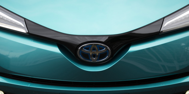 A Toyota Motor Corp. C-HR hybrid sport utility vehicle (SUV) is displayed in a parking lot during a media event held ahead of the sales launch in Tokyo, Japan, on Tuesday, Dec. 13, 2016. The new C-HR models designers applied a sexy diamond theme inside and out, from the sharply sloped rear window to the rhombus-patterned door trim, chief engineer Hiroyuki Koba told reporters Wednesday in Tokyo. Photographer: Tomohiro Ohsumi/Bloomberg via Getty Images