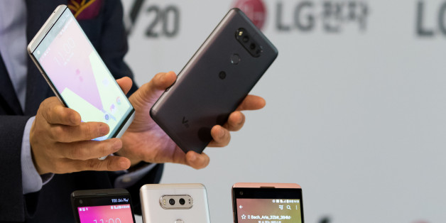 Cho Jun-Ho, chief executive officer of Mobile Communications at LG Electronics Inc., holds the company's V20 smartphones during a launch event in Seoul, South Korea, on Wednesday, Sept. 7, 2016. The V20 will go on sale in South Korea starting this month, with other regions to follow, according to the company. Photographer: SeongJoon Cho/Bloomberg via Getty Images