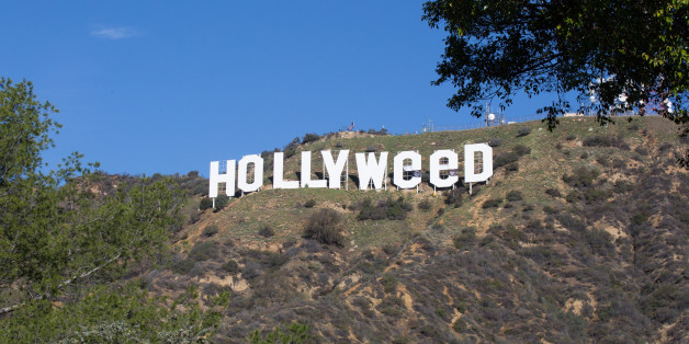 HOLLYWOOD, CA - JANUARY 01:  The Iconic Hollywood Sign Gets Changed To Read 'Hollyweed' on January 1, 2017 in Hollywood, California.  (Photo by Gabriel Olsen/Getty Images)