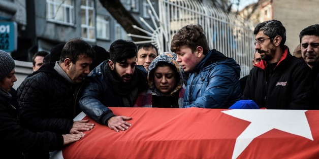 Relatives of Ayhan Arik, one of the victims of the Reina night club attack mourn during his funeral ceremony on January 1, 2017 in Istanbul.Thirty-nine people, including many foreigners, were killed early on January 1, 2016 when a gunman went on a rampage at an exclusive nightclub in Istanbul where revellers were celebrating the New Year. / AFP / OZAN KOSE        (Photo credit should read OZAN KOSE/AFP/Getty Images)