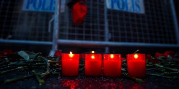 ISTANBUL, TURKEY - JANUARY 01: Carnations and candles are placed at site to pay tribute to victims of Istanbul night club terror attack in Istanbul, Turkey on January 01, 2017. (Photo by Arif Hudaverdi Yaman/Anadolu Agency/Getty Images)