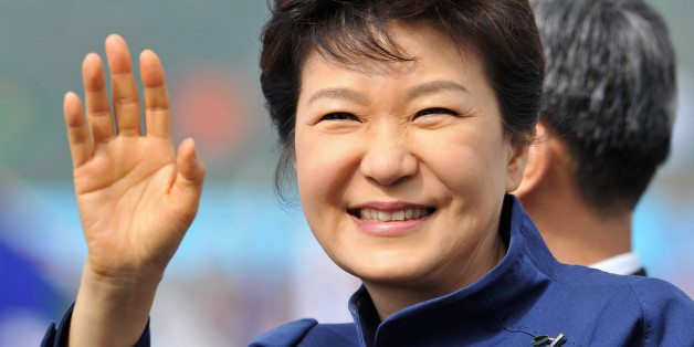South Korean President Park Geun-Hye waves as she inspects troops during a ceremony marking the 65th anniversary of the founding of South Korea's Armed Forces at an air base in Seongnam, south of Seoul October 1, 2013. REUTERS/Jung Yeon-je/Pool (SOUTH KOREA - Tags: POLITICS MILITARY ANNIVERSARY)