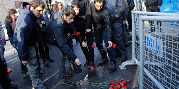 Men lay flowers outisde the Reina nightclub by the Bosphorus, which was attacked by a gunman, in Istanbul, Turkey, January 1, 2017.       REUTERS/Umit Bektas