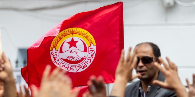 TUNIS, TUNISIA - MAY 1 :  Tunisians gather outside the headquarters of the Tunisian General Labour Union UGTT to attend a May Day Rally in Tunis, Tunisia on May 1, 2016. (Photo by Amine Landoulsi/Anadolu Agency/Getty Images)