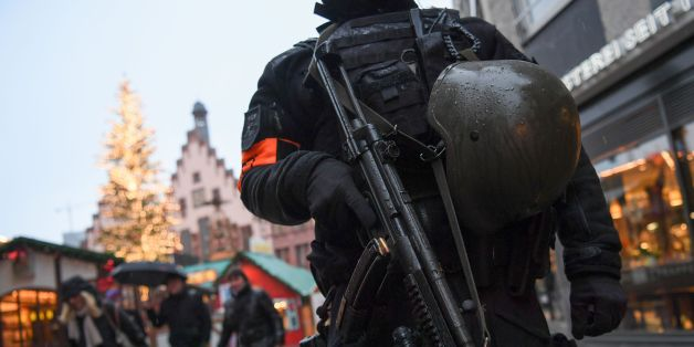 A policeman with machine gun stands guard at the Christmas market at the Roemerberg in the centre of Frankfurt am Main, western Germany, on December 22, 2016, as security measures are taken after the deadly Christmas market attack in Berlin.