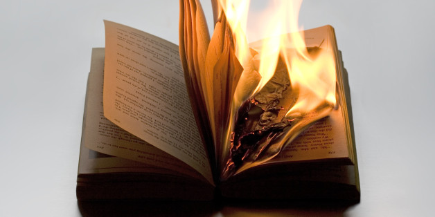 Burning book on white background. It refers to disregard for wisdom, history and knowledge. It points out to Fascist movement. It can refer to anarchy and punk.