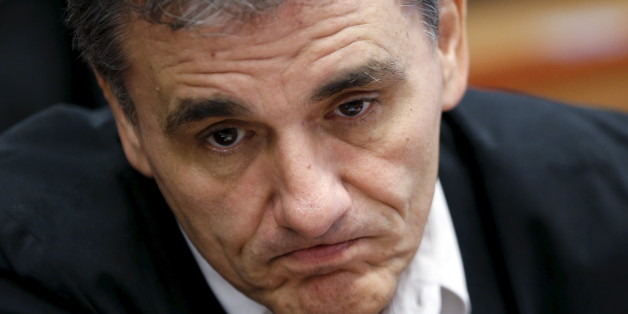 Greek Finance Minister Euclid Tsakalotos reacts at the start of a euro zone finance ministers meeting in Brussels, Belgium, August 14, 2015. Euro zone finance ministers will discuss whether to agree a third bailout package for Greece on Friday at their meeting in Brussels after the Greek parliament voted to approve the terms. REUTERS/Francois Lenoir