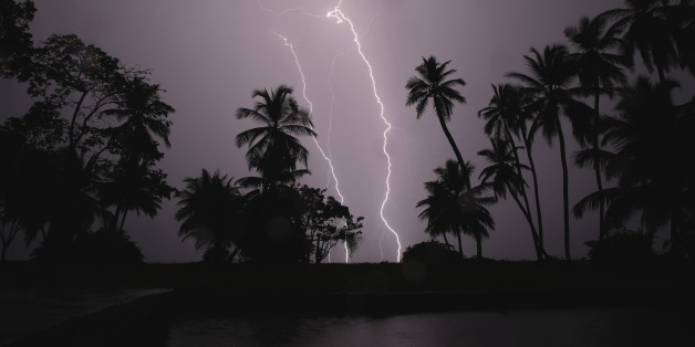 Lightning strikes over Lake Maracaibo in the village of Ologa, where the Catatumbo River feeds into the lake, in the western state of Zulia October 23, 2014. This year the Catatumbo Lightning was approved for inclusion in the 2015 edition of Guinness World Records, dethroning the Congolese town of Kifuka as the place with the world's most lightning bolts per square kilometer each year at 250. Scientists think the Catatumbo, named for a river that runs into the lake, is normal lightning that just happens to occur far more than anywhere else, due to local topography and wind patterns. Picture taken with long exposure October 23, 2014.  REUTERS/Jorge Silva (VENEZUELA - Tags: SOCIETY ENVIRONMENT TPX IMAGES OF THE DAY)  ATTENTION EDITORS: PICTURE 10 OF 20 FOR WIDER IMAGE PACKAGE 'VENEZUELA'S ETERNAL STORM'   TO FIND ALL IMAGES SEARCH 'CATATUMBO LIGHTNING'