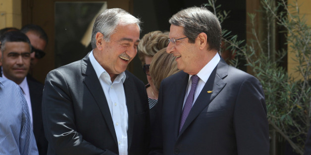 Greek Cypriot leader and Cyprus President Nicos Anastasiades (R) shakes hands with Turkish Cypriot leader Mustafa Akinci during an event organized by the Bi-communal Technical Committee on Education in Nicosia, Cyprus June 2, 2016. REUTERS/Yiannis Kourtoglou