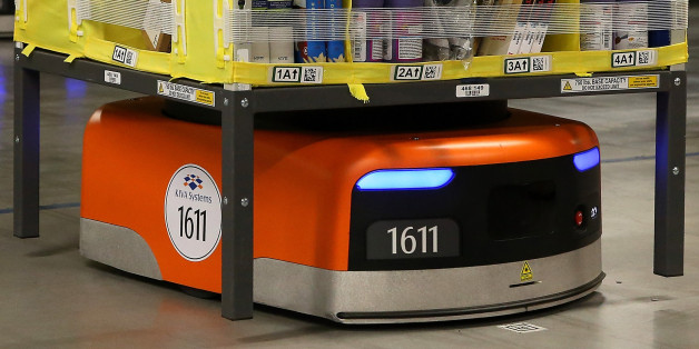 TRACY, CA - JANUARY 20:  A Kiva robot moves a rack of merchandise at an Amazon fulfillment center on January 20, 2015 in Tracy, California. Amazon officially opened its new 1.2 million square foot fulfillment center in Tracy, California that employs more than 1,500 full time workers as well as 3,000 Kiva robots that can fetch merchandise for workers and are capable of lifting up to 750 pounds. Amazon is currently using 15,000 of the robots spread over 10 fulfillment centers across the country.  (Photo by Justin Sullivan/Getty Images)