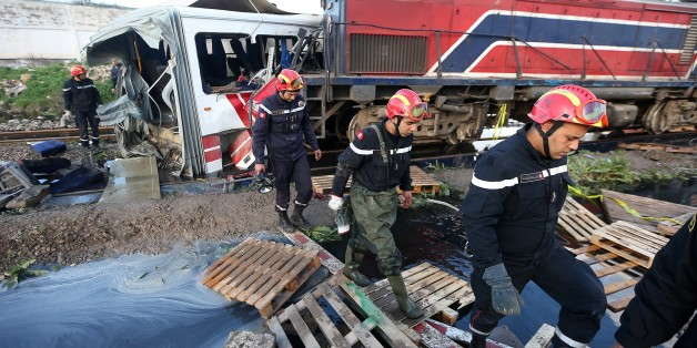 TUNIS, TUNISIA - DECEMBER 28: Tunisian security officers and civil defense team members gather at the site of a collision, after a train slammed into a public bus in Jebel Jalloud region of the Tunisian capital on December 28, 2016. At least five people were killed and many injured when a train slammed into a public bus near Tunis.