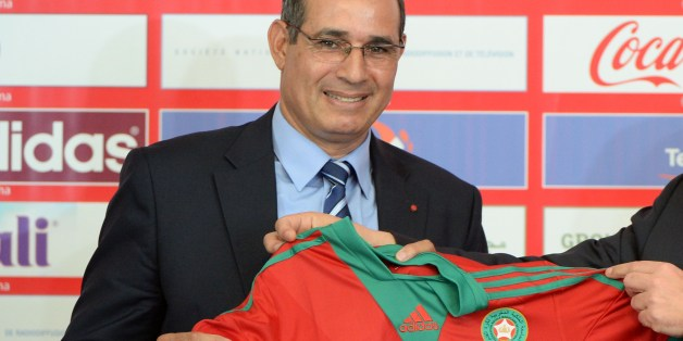 Morocco's Atlas Lions newly appointed coach Badou Zaki poses with the national jersey on May 2, 2014 during a press conference in Rabat. AFP PHOTO / FADEL SENNA        (Photo credit should read FADEL SENNA/AFP/Getty Images)