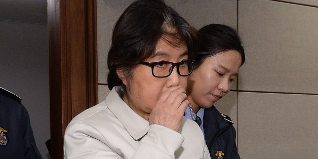SEOUL, SOUTH KOREA - DECEMBER 19:  (SOUTH KOREA OUT) Choi Soon-Sil, the jailed confidante of disgraced South Korean President Park Geun-Hye, appears for the first day of her trial at the Seoul Central District Court on December 19, 2016 in Seoul, South Korea. Choi Soon-sil, the close friend of President Park Geun-hye, who is at the center of possible corruption scandal that has been leading the president's impeachment appeared at the first court hearing.  (Photo by Korea Pool via Getty Images)