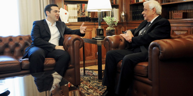 Greek Prime Minister Alexis Tsipras (L) talks to Greek President Prokopis Pavlopoulos during a meeting at the presidential palace in Athens, Greece November 20, 2015. The conclusion of the recapitalisation of Greece's banks will mark an end to a period of uncertainty, the country's Prime Minister Alexis Tsipras said on Friday. REUTERS/Michalis Karagiannis