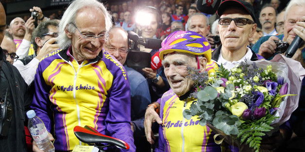 SAINT-QUENTIN-EN-YVELINES, FRANCE - JANUARY 04:  French centenarian cyclist Robert Marchand, aged 105 reacts after cycling in a bid to beat his record for distance cycled in one hour in the over-105 age group at the indoor velodrome National of Saint-Quentin En Yvelines on January 04, 2017 in Montigny Le Bretonneux, France. At 105, Robert Marchand established an hour world record by bike, traveling 22,547 kilometers (14.08 miles), in the over-105 age group.  (Photo by Chesnot/Getty Images)