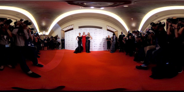 DUBAI, UNITED ARAB EMIRATES - DECEMBER 12: (EDITOR'S NOTE: Image was created as an Equirectangular Panorama. Import image into a panoramic player to create an interactive 360 degree view.)  Eva Longoria, Melanie Griffith and Anastacia pose for photographers at the Global Gift Gala during day six of the 13th annual Dubai International Film Festival on December 12, 2016 in Dubai, United Arab Emirates.  (Photo by Ming Yeung/Getty Images)