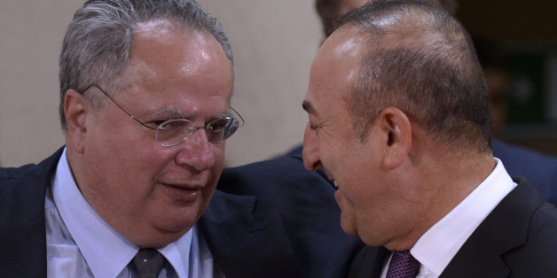 (LtoR) Greek Foreign Affairs Minister Nikolaos Kotzias talks with Turkish Foreign Affairs minister Mevlut Cavusoglu during a foreign affairs ministers meeting at the NATO headquarters in Brussels on May 19, 2016. 