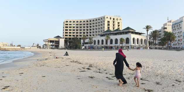 SOUSSE, TUNISIA - JUNE 22: A young woman walks along the beach front in front of the once popular but now closed down Hotel Boujafar in Sousse in the north of Tunisia where the country's tourism industry has fallen into a steep decline since last year's terror attacks, on June 22, 2016 in Tunis, Tunisia. One year ago, on 26th June 2015, a radicalised Tunisian student, Seifeddine Rezgui, killed 38 people in a terrorist attack on the beaches of the popular holiday resort of Sousse leading the Brit